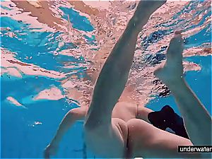 teen lady Avenna is swimming in the pool
