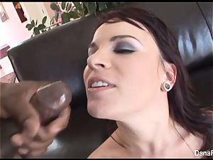 Dana gets her booty inserted with a large black knobs
