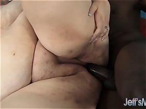 Fatty Desiree Devine takes a black meatpipe
