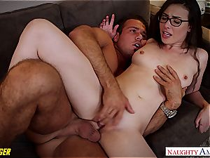Casey Calvert in glasses gets munched and pummeled in a car