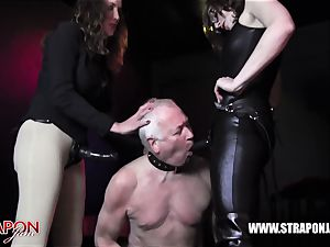 Femdoms latex predominate tag team sissy face smash strap on dildo
