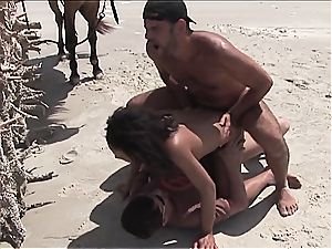 insatiable mexican woman gets 2 lollipops on the beach