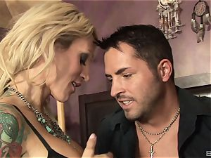 blond cougar with hefty fake tits Sarah Jessie