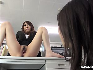 Office hoe caresses her moist cunt on the table